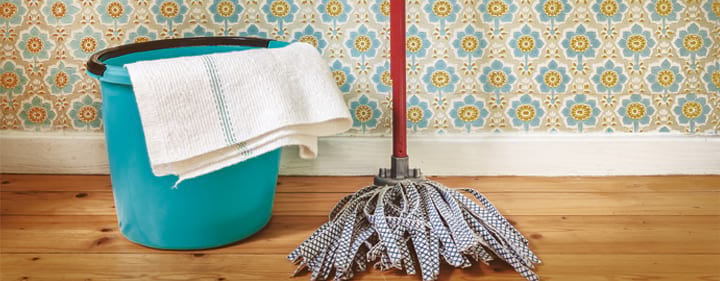 mop and pail on flower wallpaper background